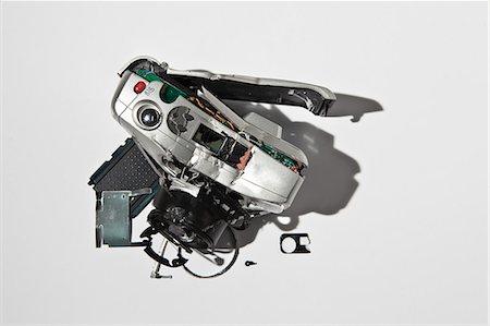 Close up of smashed digital camera Stock Photo - Premium Royalty-Free, Code: 649-06165312