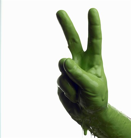 paint drips - Green painted hand making peace sign Stock Photo - Premium Royalty-Free, Code: 649-06165334
