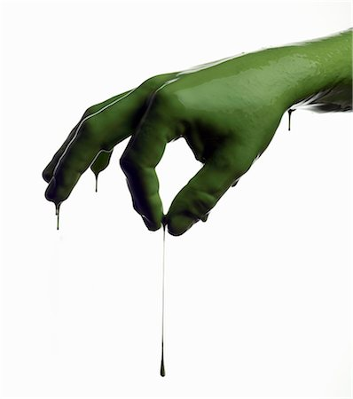 paint drips - Green painted hand pinching Stock Photo - Premium Royalty-Free, Code: 649-06165335