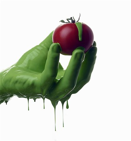 paint drips - Green painted hand holding tomato Stock Photo - Premium Royalty-Free, Code: 649-06165336