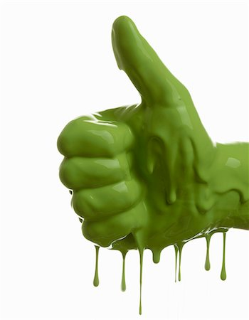 Green painted hand making thumbs-up Stock Photo - Premium Royalty-Free, Code: 649-06165332