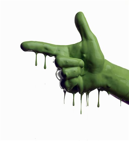 Green painted hand pointing Stock Photo - Premium Royalty-Free, Code: 649-06165333