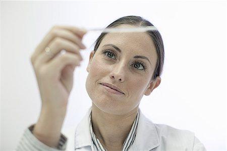 Doctor reading test strip Stock Photo - Premium Royalty-Free, Code: 649-06304822