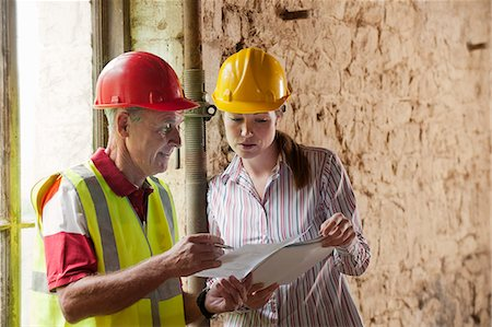 reviewing - Construction workers examining papers Stock Photo - Premium Royalty-Free, Code: 649-06304896