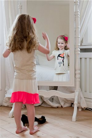 dress up girl - Girl admiring herself in mirror Stock Photo - Premium Royalty-Free, Code: 649-06304931