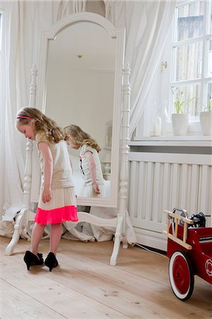 dress up girl - Girl wearing mothers high heels Stock Photo - Premium Royalty-Free, Code: 649-06304932