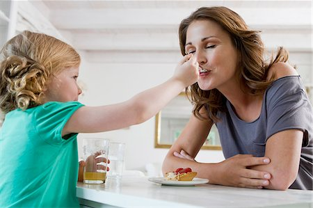 self indulgence - Girl feeding mother breakfast Stock Photo - Premium Royalty-Free, Code: 649-06304943