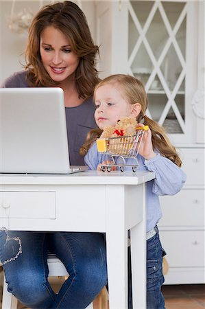 Mother and daughter using laptop Stock Photo - Premium Royalty-Free, Code: 649-06304951
