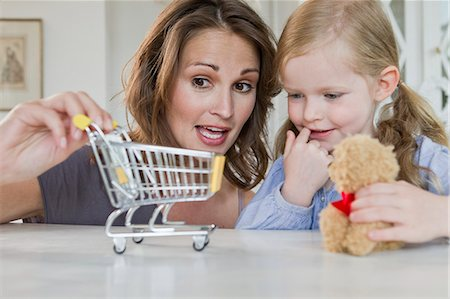 Mother and daughter playing with toys Stock Photo - Premium Royalty-Free, Code: 649-06304953