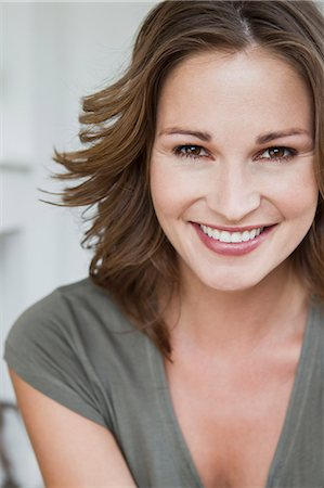 Close up of womans smiling face Stock Photo - Premium Royalty-Free, Code: 649-06304975