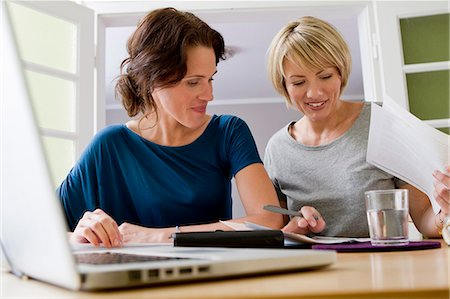 Women working together on laptop Stock Photo - Premium Royalty-Free, Code: 649-06305004