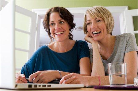 Women using laptop together Stock Photo - Premium Royalty-Free, Code: 649-06305007