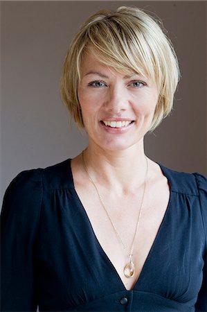 short hair - Close up of woman smiling Stock Photo - Premium Royalty-Free, Code: 649-06305009