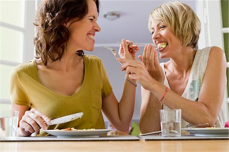 Smiling women having lunch together Stock Photo - Premium Royalty-Free, Code: 649-06305000