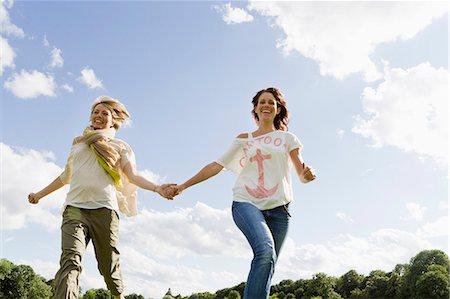 Smiling women running outdoors Stock Photo - Premium Royalty-Free, Code: 649-06305015