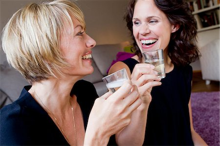 Women drinking champagne together Stock Photo - Premium Royalty-Free, Code: 649-06305010
