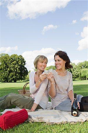 Women drinking champagne at picnic Stock Photo - Premium Royalty-Free, Code: 649-06305023