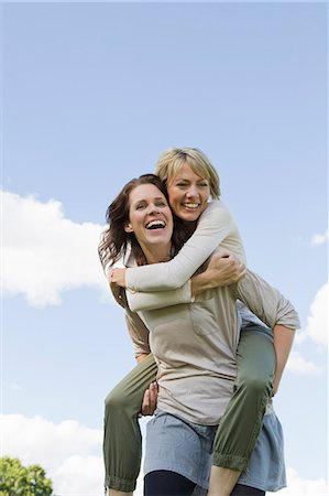 Woman giving her friend a piggy back Stock Photo - Premium Royalty-Free, Code: 649-06305030