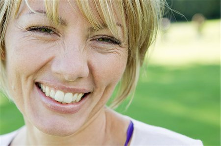 Close up of womans smiling face Stock Photo - Premium Royalty-Free, Code: 649-06305031