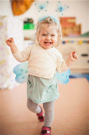 Smiling girl wearing fairy costume Stock Photo - Premium Royalty-Free, Code: 649-06305092