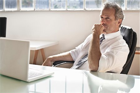 Businessman thinking at desk Stock Photo - Premium Royalty-Free, Code: 649-06305267