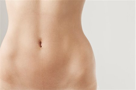 female nude hip - Detail view of womans naked belly Stock Photo - Premium Royalty-Free, Code: 649-06305291