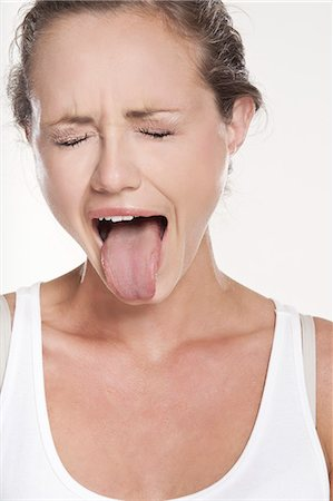 Close up of woman grimacing Stock Photo - Premium Royalty-Free, Code: 649-06305317