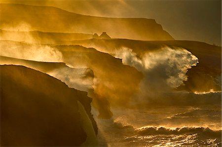 rugged landscape - Waves crashing on rocky cliffs Stock Photo - Premium Royalty-Free, Code: 649-06305356