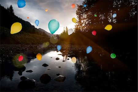 flying - Balloons floating over still rocky lake Stock Photo - Premium Royalty-Free, Code: 649-06305436