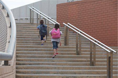 Children climbing stairs outdoors Stock Photo - Premium Royalty-Free, Code: 649-06305486