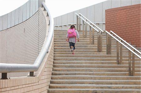 Girl climbing steps outdoors Stock Photo - Premium Royalty-Free, Code: 649-06305482