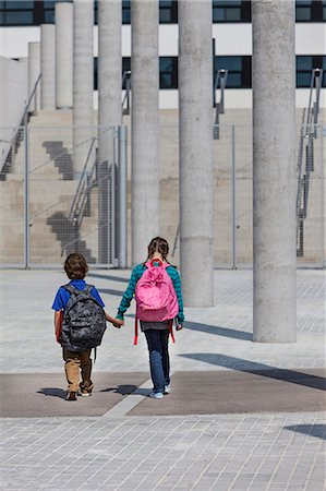 Children holding hands in courtyard Stock Photo - Premium Royalty-Free, Code: 649-06305516
