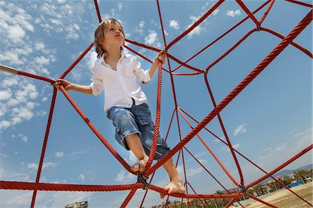 Boy playing on ropes on beach Stock Photo - Premium Royalty-Free, Code: 649-06305527