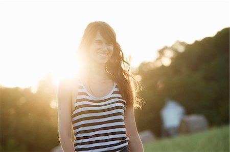 Smiling woman walking outdoors Stock Photo - Premium Royalty-Free, Code: 649-06305542