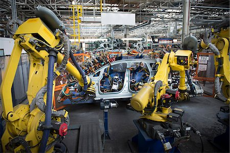 production - Robots welding car body in car factory Stock Photo - Premium Royalty-Free, Code: 649-06305614