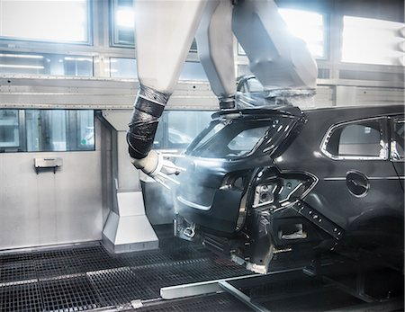 Paint spraying robots in car factory Stock Photo - Premium Royalty-Free, Code: 649-06305668