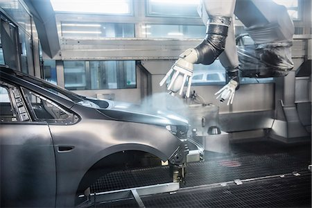 Paint spraying robots in car factory Stock Photo - Premium Royalty-Free, Code: 649-06305669