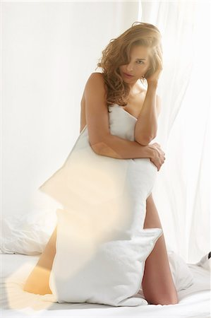 front - Nude woman covering body with pillow Stock Photo - Premium Royalty-Free, Code: 649-06305747