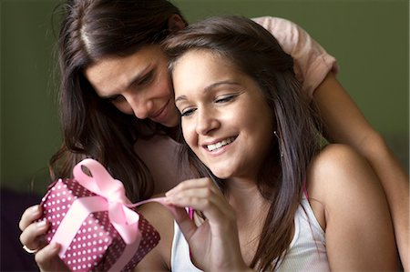 present wrapped close up - Smiling women exchanging gifts Stock Photo - Premium Royalty-Free, Code: 649-06305788