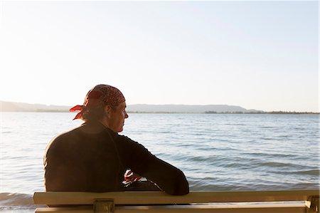 people sitting on bench - Man sitting on bench at beach Stock Photo - Premium Royalty-Free, Code: 649-06305820