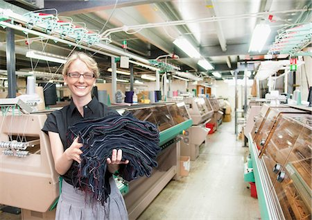 Worker with fabric in garment factory Stock Photo - Premium Royalty-Free, Code: 649-06305900