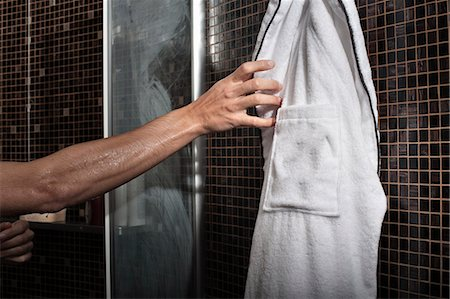 shower - Man reaching for bathrobe in shower Stock Photo - Premium Royalty-Free, Code: 649-06305924