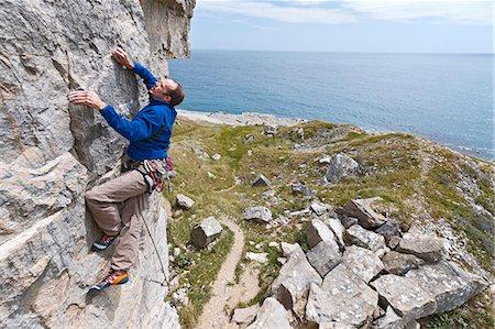 rock climber - Climber scaling steep cliff face Stock Photo - Premium Royalty-Free, Code: 649-06306006
