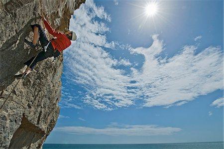 rock climber - Climber scaling steep cliff face Stock Photo - Premium Royalty-Free, Code: 649-06306007