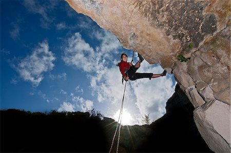 Climber scaling rock face Stock Photo - Premium Royalty-Free, Code: 649-06306002
