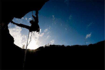 rock climber - Climber scaling rock face Stock Photo - Premium Royalty-Free, Code: 649-06306003