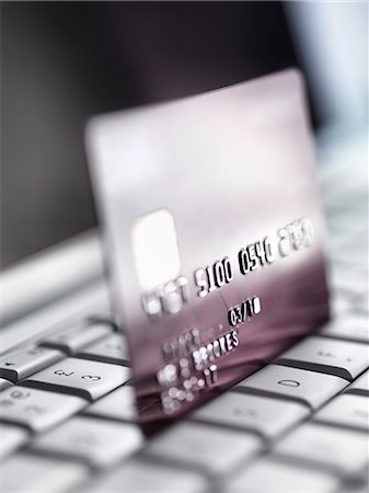 selective focus computer no people - Close up of credit card on keyboard Stock Photo - Premium Royalty-Free, Code: 649-06352450