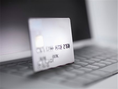 selective focus computer no people - Close up of credit card on keyboard Stock Photo - Premium Royalty-Free, Code: 649-06352451