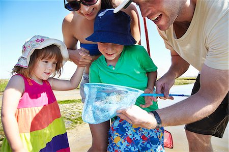 Family fishing with nets outdoors Stock Photo - Premium Royalty-Free, Code: 649-06352466