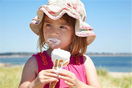 eating ice cream - Girl eating ice cream on beach Stock Photo - Premium Royalty-Free, Code: 649-06352474